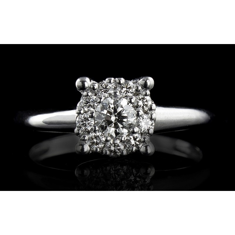 Ring of 18К gold, with a central diamond at your choice and 9 diamonds with a weight of 0.163ct.