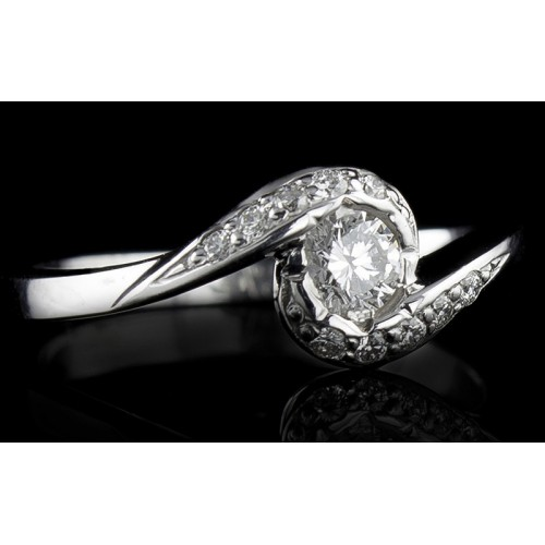 Ring of 18К gold, with a central diamond at your choice and 10 diamonds with a weight of 0.07ct.