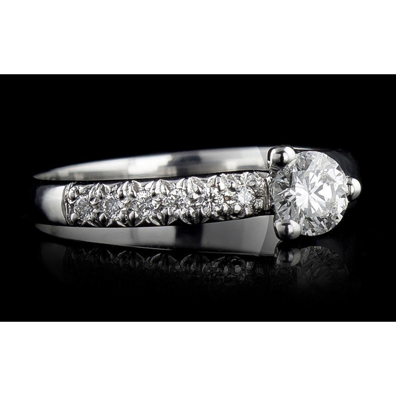 Ring of 18К gold, with a central diamond at your choice and 6 diamonds with a weight of 0.06ct.