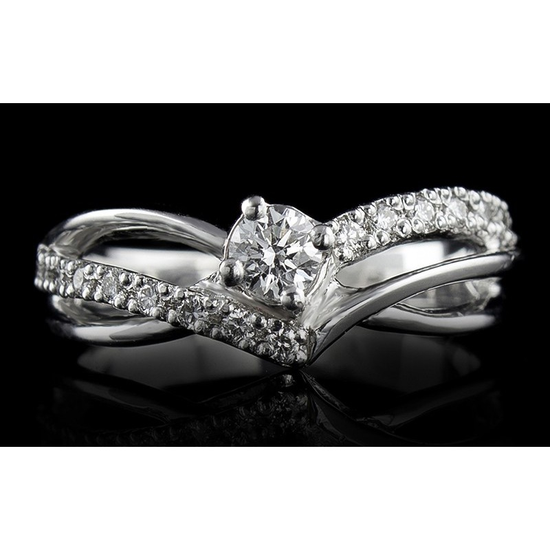 Ring of 18К gold, with a central diamond at your choice and 16 diamonds with a weight of 0.145ct.
