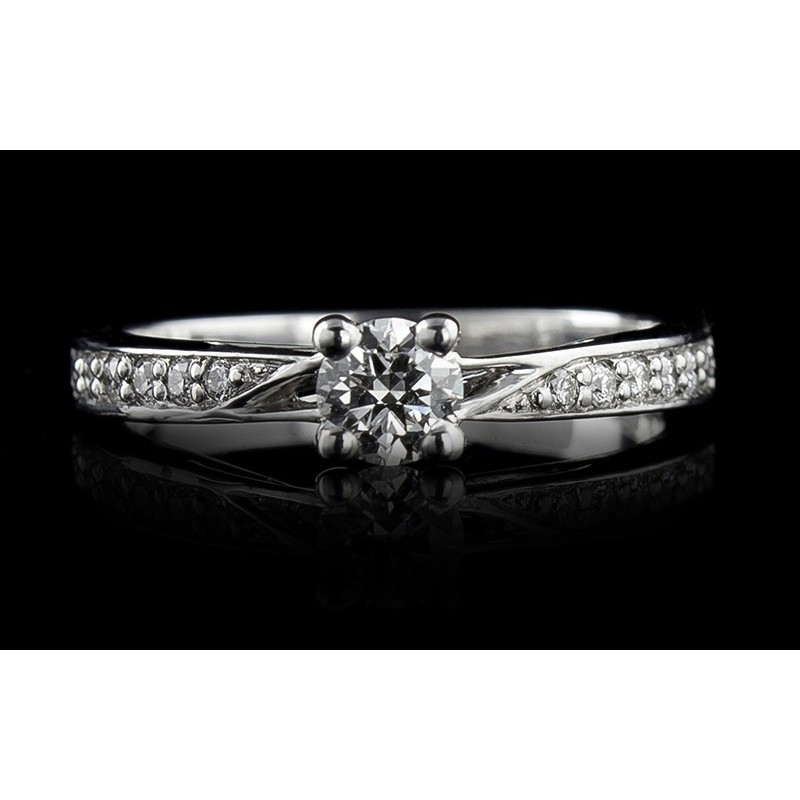 Ring of 18К gold, with a central diamond at your choice, 12 diamonds with a weight of 0.11ct.