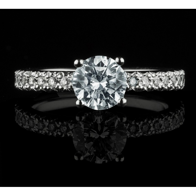 Ring of 18К gold, with a central diamond at your choice and 20 diamonds with a weight of 0.19ct.