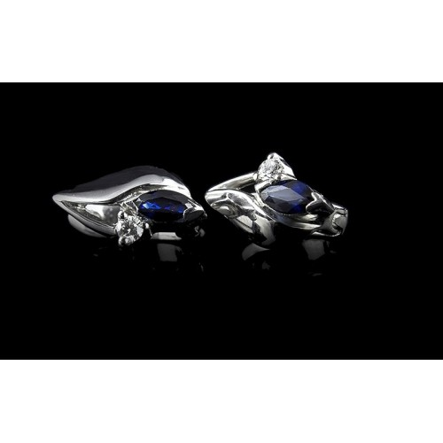 """Earrings """"Sapphire Touch"""", 18K white gold, 2 diamonds with a weight of 0.065ct and a sapphire with a weight of 0.485ct."""
