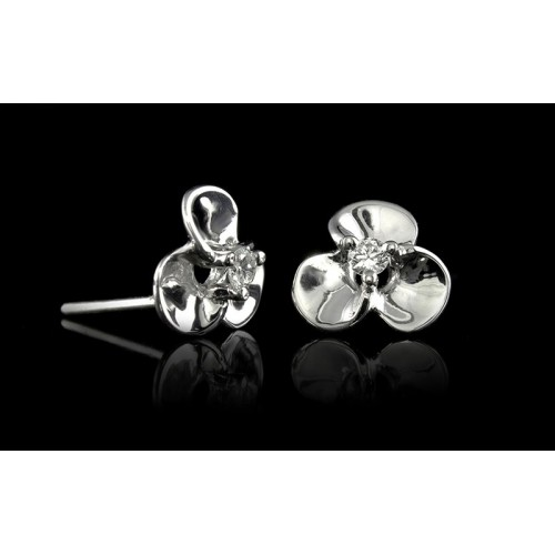 """Earrings """"Harmony"""", 18K white gold, 2 diamonds with a weight of 0.12ct."""