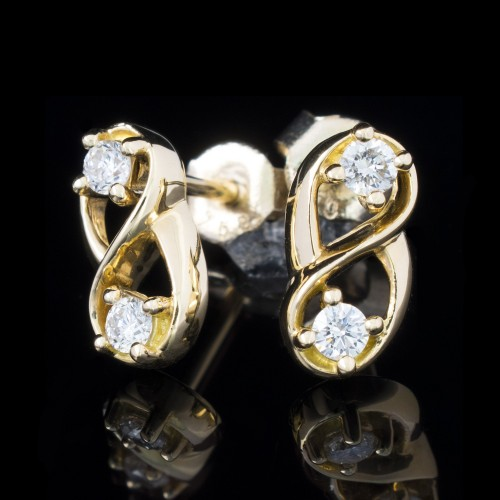 Earrings 18K yellow gold, 4 diamonds with a weight of 0.24ct.