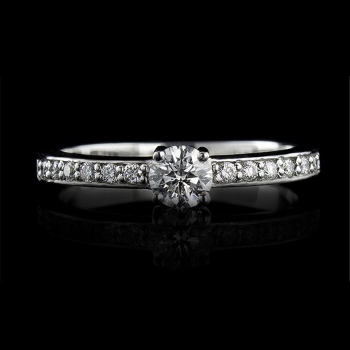 Engagement ring of 18К gold, 1 diamond with a weight of 0.24ct and 12 diamonds with a weight of 0.11ct.