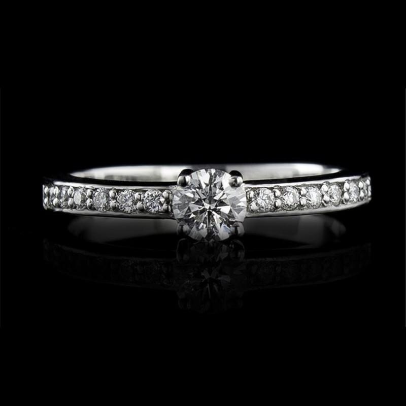 Годежен пръстен 18К злато, 1 диамант с тегло 0.24ct и 12 диаманта с тегло 0.11ct.