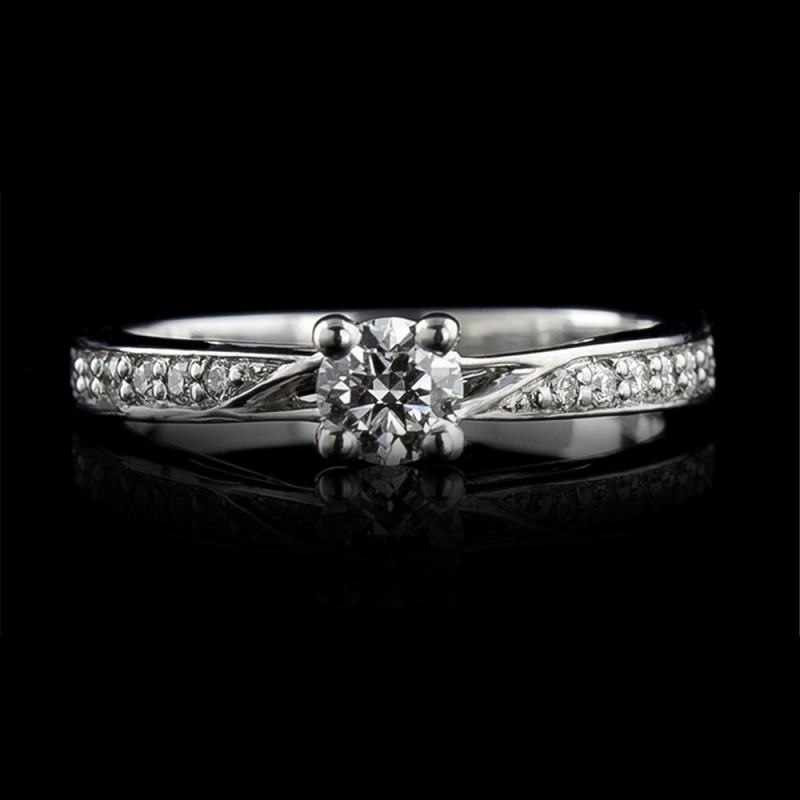 Engagement ring of 18К gold, 1 diamond with a weight of 0.32ct and 12 diamonds with a weight of 0.11ct.