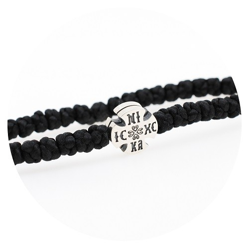Bracelet with black thread and silver cross 925