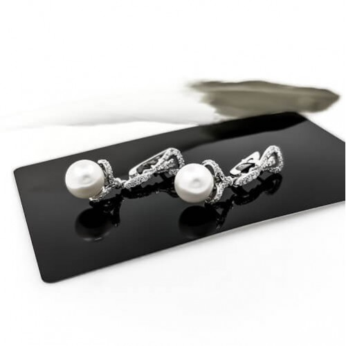 Earrings, 14K white gold, 84 diamonds with a weight of 0.78 ct and 2 pearls