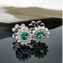 Earrings, 14K white gold with 2 emeralds and diamonds 0.17ct