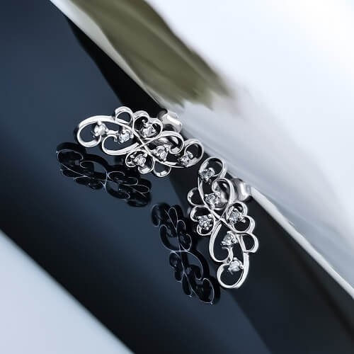 Earrings, 14K white gold, 12 diamonds with a weight of 0.21ct