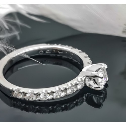 Engagement ring of 18К gold, 1 diamond with a weight of 0.30ct and 12 diamonds with a weight of 0.36ct.
